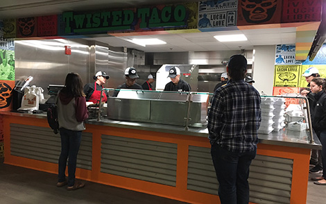students waiting in line at twisted taco