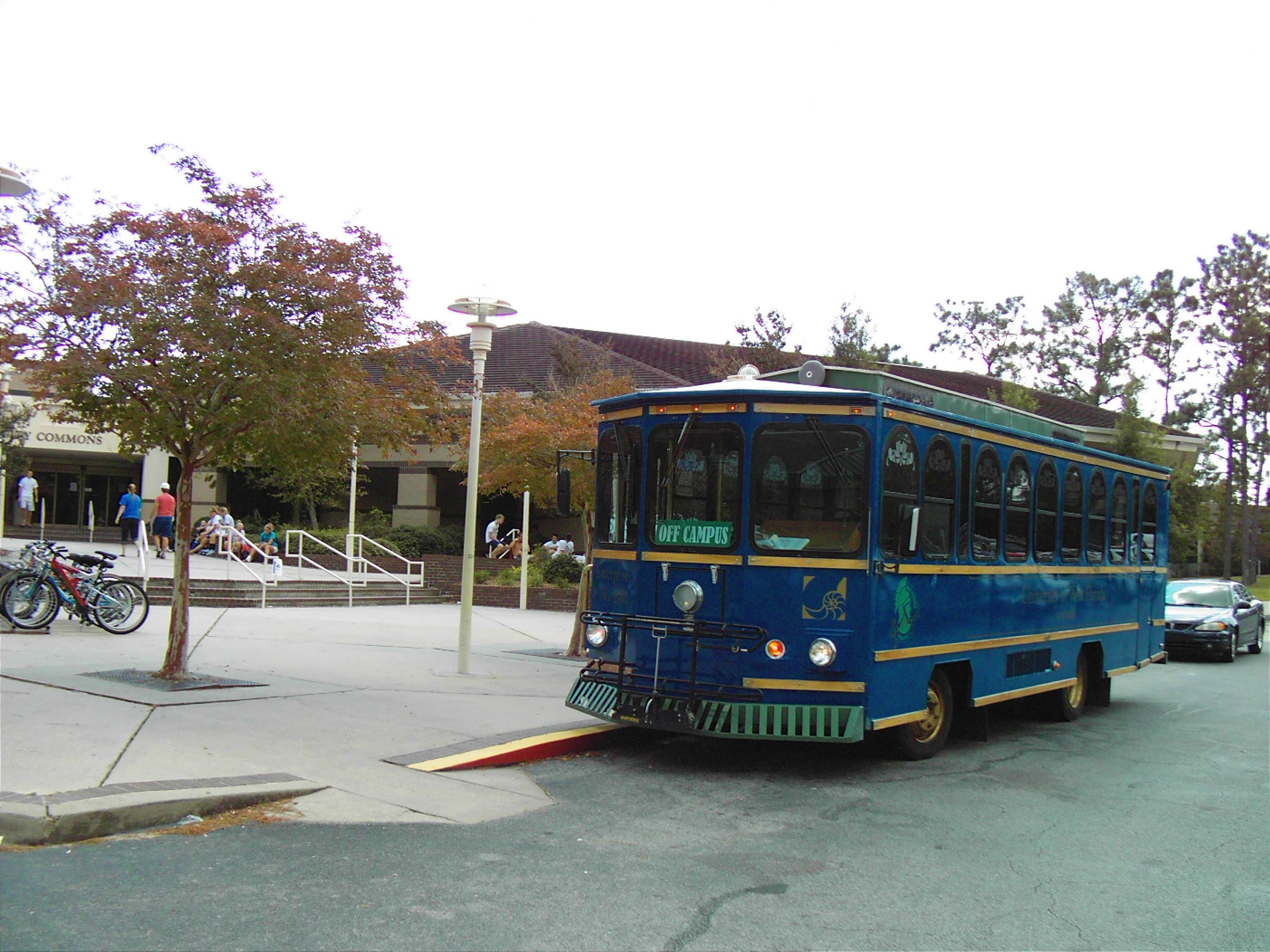 Image of the UWF Trolley parked in front of the UWF Commons.