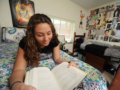 Student reading book in suite-style double room