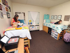 Two students studying in their traditional-style room.