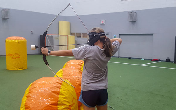 Student playing archery tag