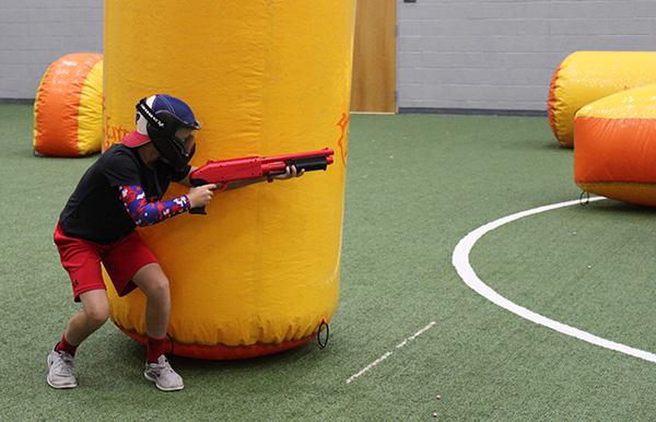 A participant playing paintball