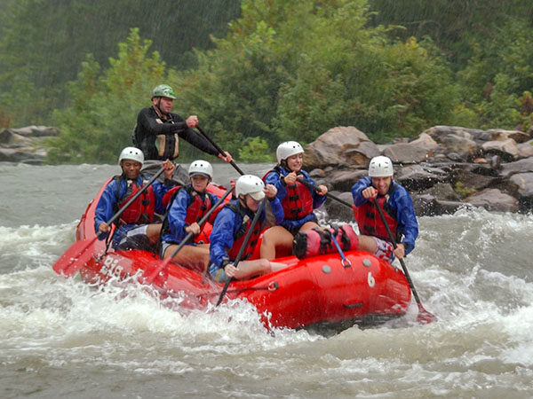 Students in a raft, navigating rapids