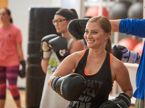 Students in a kickboxing class during the Women of the Rec event