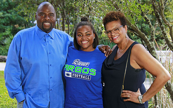 A student and their family attend a UWF event.