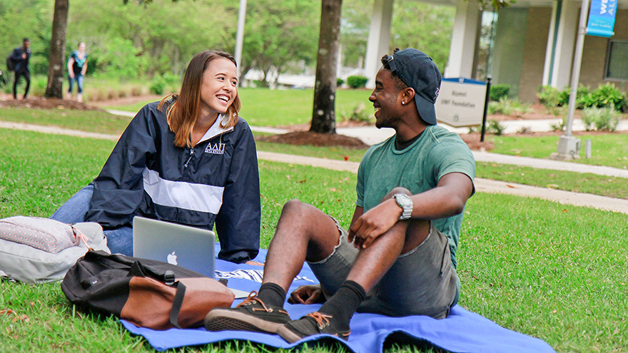 Students sitting on the lawn at UWF Pensacola campus