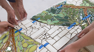 Tiles are placed on the cement bench at the University of West Florida in Pensacola, Florida