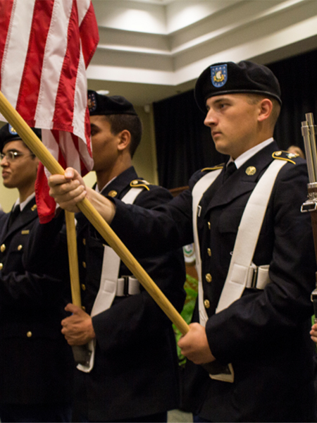 ROTC Student Holding Flag