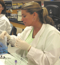 Student in the lab performing a transfusion