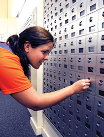Business & Auxiliary Services photo of student opening post office box