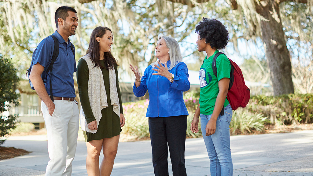 Medium version of the image of UWF's 6th President, Dr. Martha Saunders, talking with people on campus in Pensacola