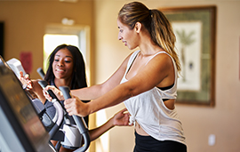 Fitness trainer with client on treadmill
