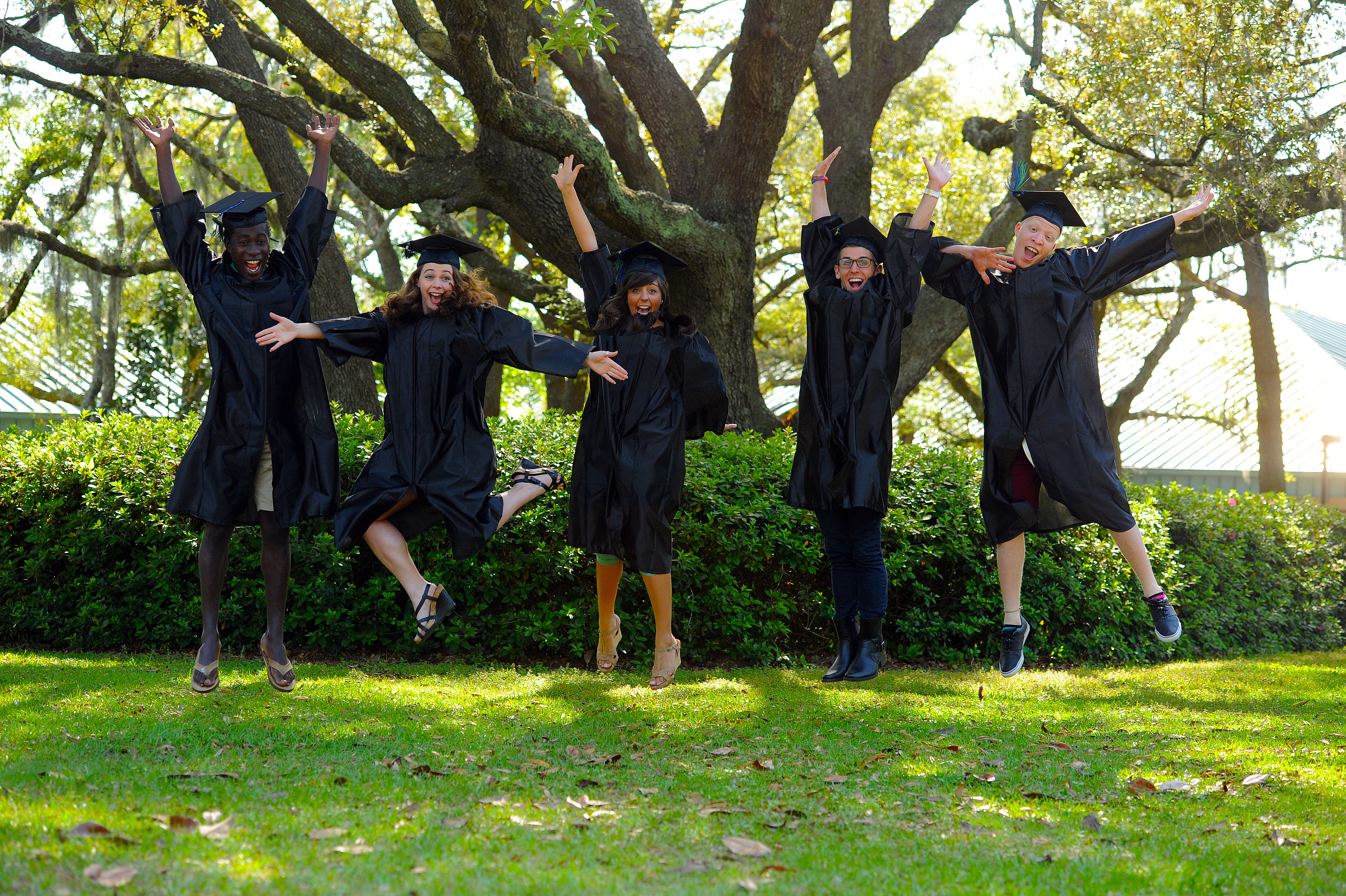 Graduating students jumping in celebration