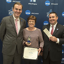 jan butts with howard reddy and dan lucas posting with her award
