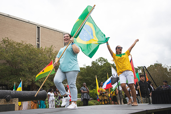 students carrying a Brazilian flag at the annual UWF Global Block Party